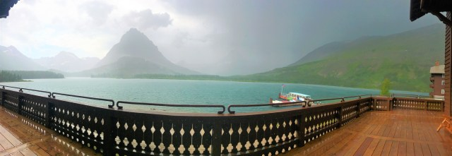 Dark clouds in skies at Swiftcurrent Lake. View from Many Glacier Hotel's Patio