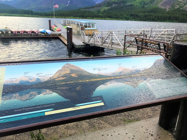 Sign board at shore of Swiftcurrent Lake Many Glacier
