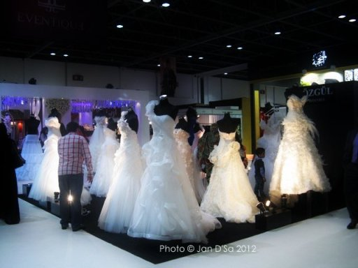 Hmmm....which gown shall I choose? One of the questions buzzing through the gal crowd passing by