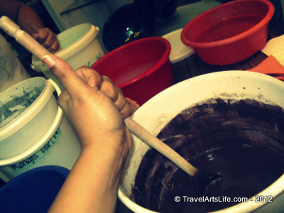 My turn to mix the glaze in with the water. Looks like a dark chocolate puddle