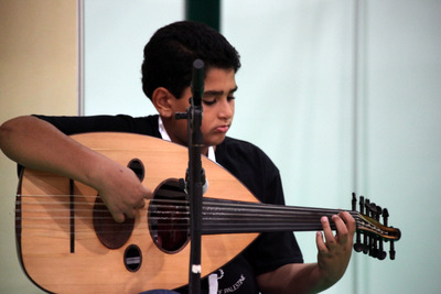 Kariem Hashim, 11 years old, plays the Oud . Photos by Hanan Awad ©