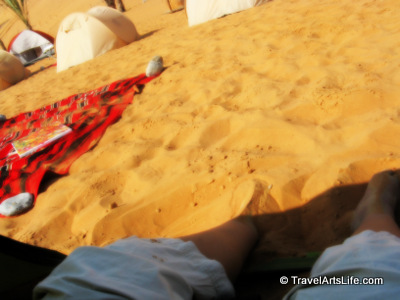 Those are my feet. It was so hot the day we were leaving, I had no choice but to dig my feet deep into the sand.