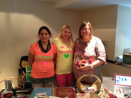 Art & Craft Bazaar at the Cristal Hotel on May 17, 2013. (From left to right) Reshma Ganapathy, Feel Great Helping volunteer, Babs Klijn, Founder of Feel Great Helping, Michal Teague, artist and coordinator of Labor of Love's 'Camp Creative' initiative.