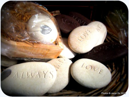 Engraved pebbles with affirmations.