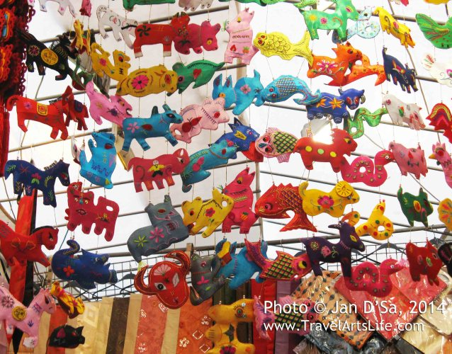 Cute stuffed toys walking on air or dancing on the ceiling