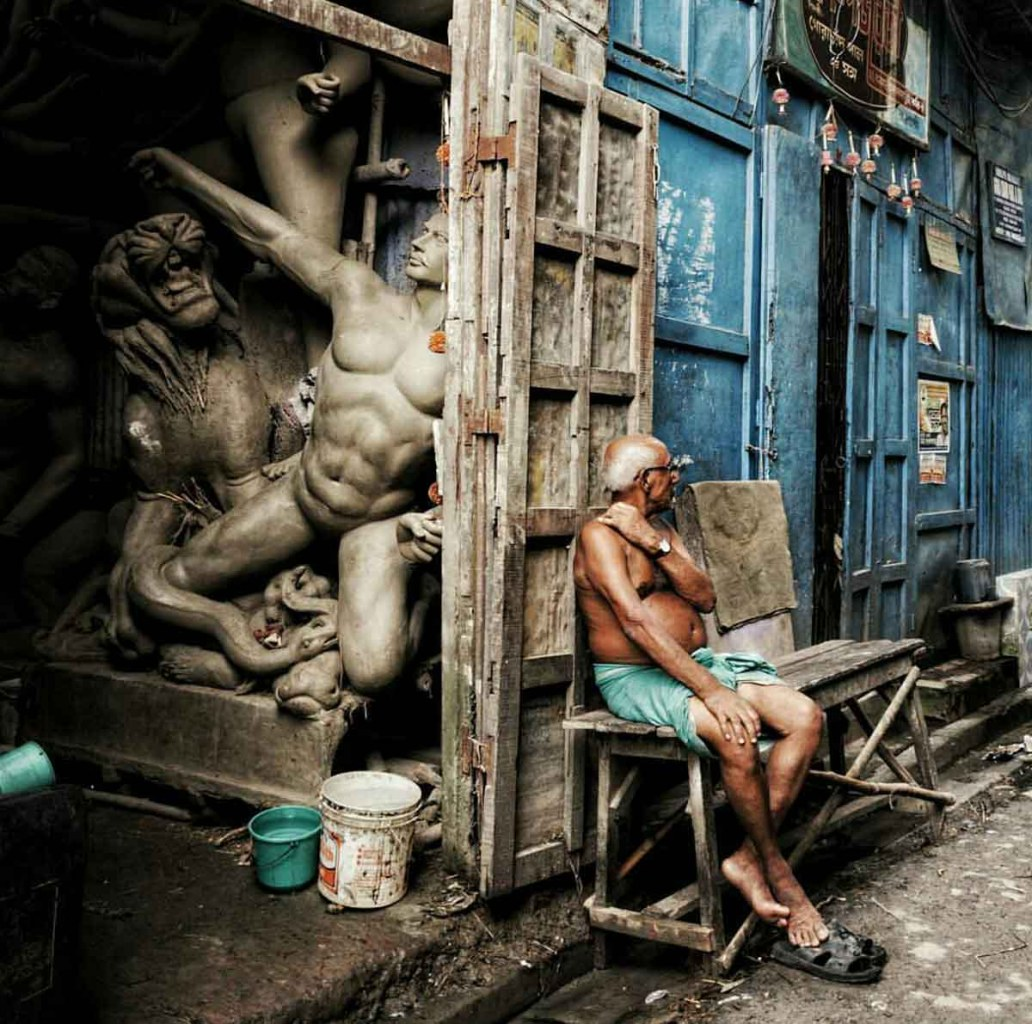 An idol maker in Kumartuli
