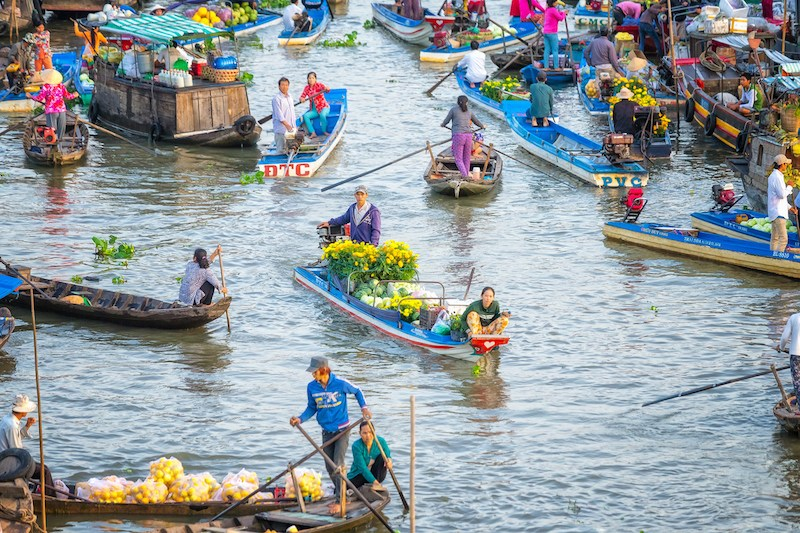 Spouses boatman selling daisies, watermelons on the river
