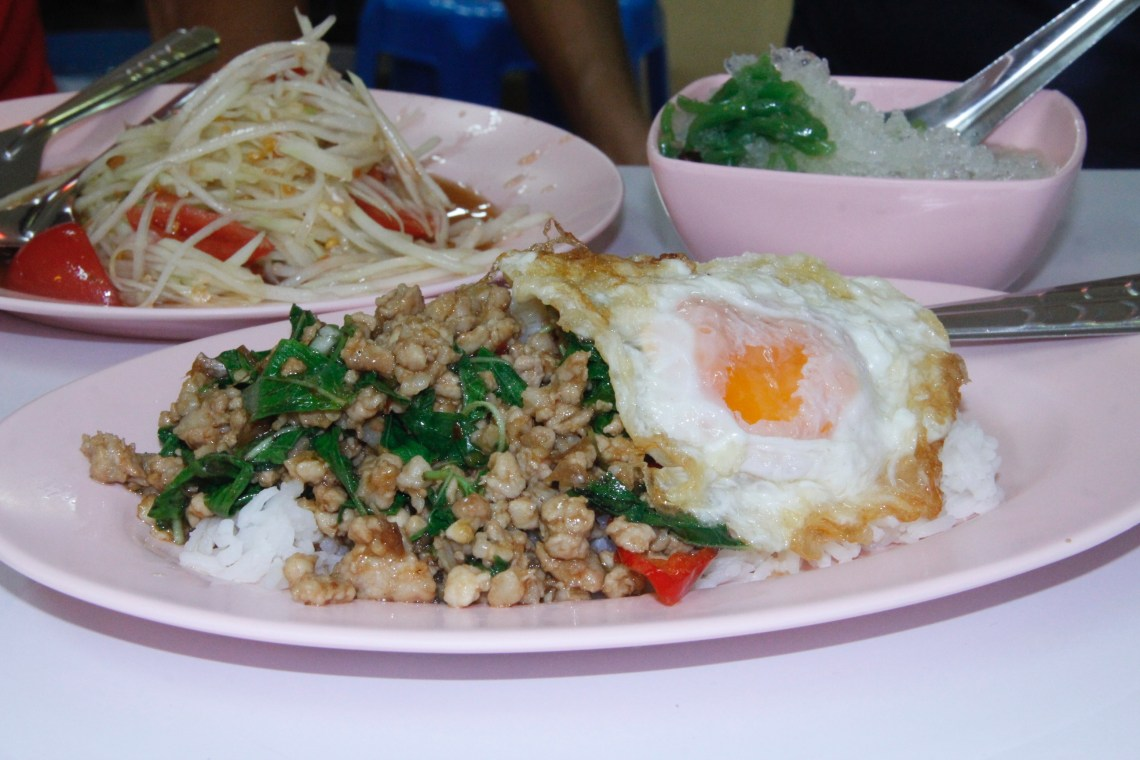 Basil pork rice dish in Bangkok