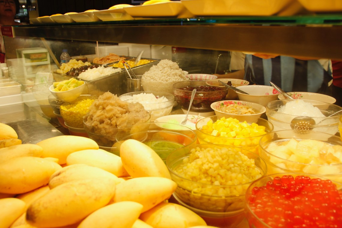 A counter of Cheng tng toppings to choose from