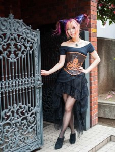 La Carmina female travel blogger modeling two horns hair and octopus corset