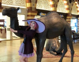 La Carmina female travel blogger with a camel in the Dubai Mall
