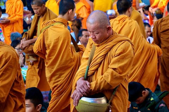 One of my favorite photos taken during the 10,000 monks procession in Chiang Mai by Evanne Allen of Poplar Travels
