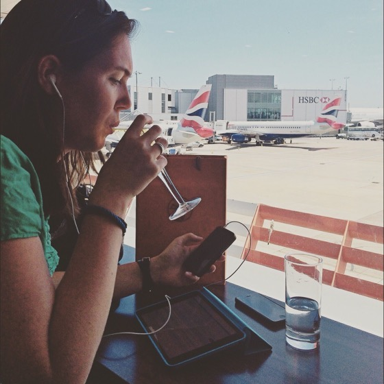 Anna Parker is a Business traveller multi-tasking at the airport