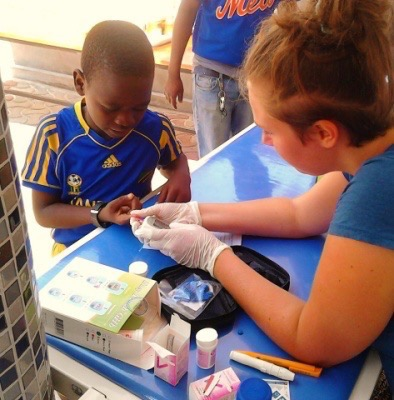 Michelle doing medical outreach while volunteering at a hospital in Dar es Salam in Tanzania.