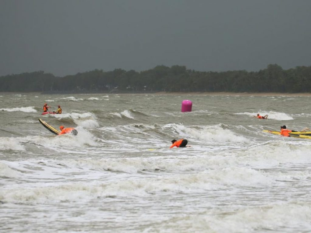 Palm Cove dished up a nasty sea for the start of Cairns Ironman70.3. Photo Cairns Post