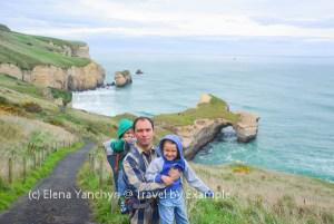 Yuriy carrying Roman and Andrey on the Tunnel Beach Track, New Zealand
