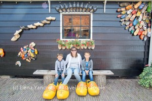 Trying on Dutch wooden shoes, Netherlands