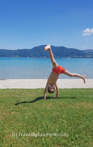 Andrey is doing cartwheels after swimming in Attersee