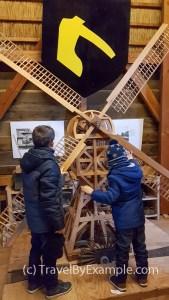 Boys learning about windmills inside Molen de Ster