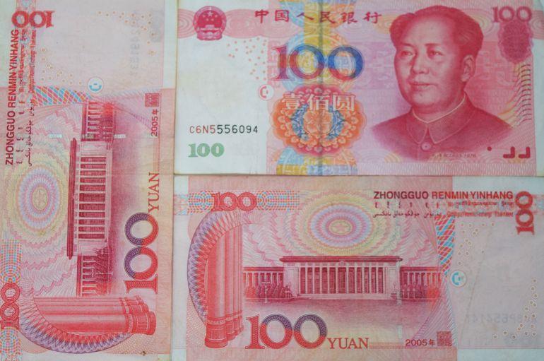 שטרות 100 יואן. הכי הרבה זיופים (צילום: טל ניצן)