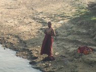 Bath time for a monk in the Ayeyarwady riveer