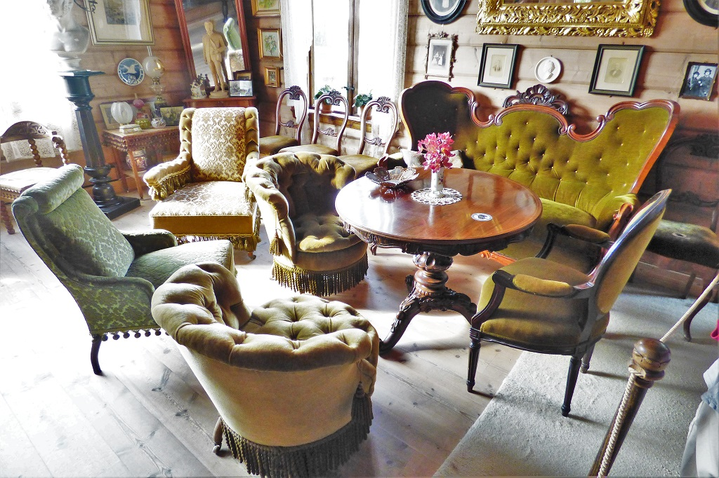 Mismatched furniture in the front room at the Edvard Grieg Museum at Troldhaugen, near Bergen