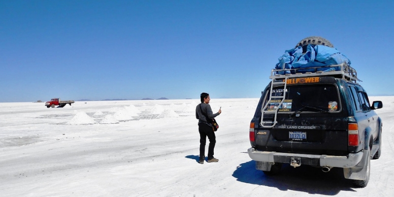 By our jeep at the Uyuni salt flats