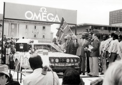 President Daniel Arap Moi flagging off cars during the Safari Rally *Originally named the Coronation Safari, by the 1960s the event had become the East African Safari Rally