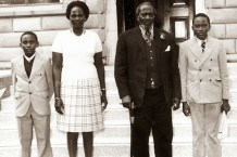 President Kenyatta is pictured with his family on arrival at his Gatundu home from Mombasa where he had been on a two-week working holiday on September 7, 1973. His son Uhuru Kenyatta stands next to him