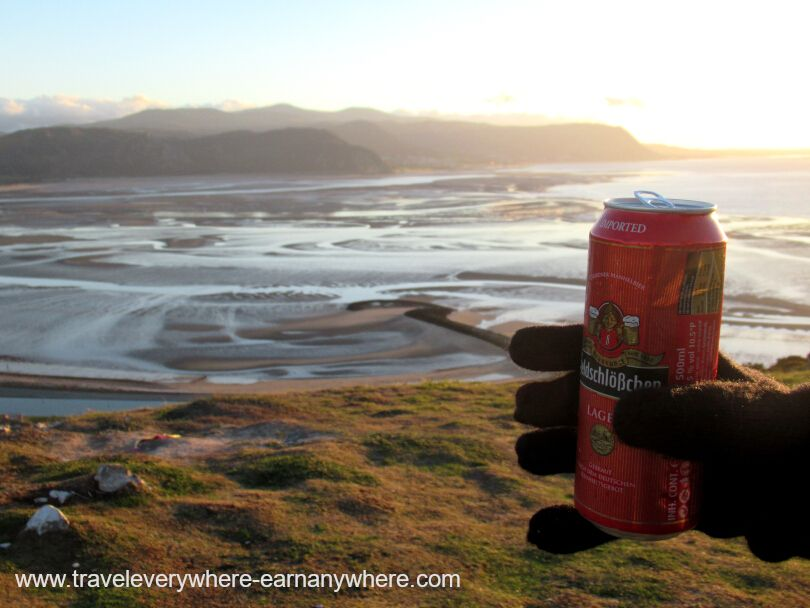 Watching the sunset on The Orme with a beer