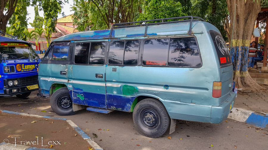 A battered mini bus at the Probolinggo Bus Station