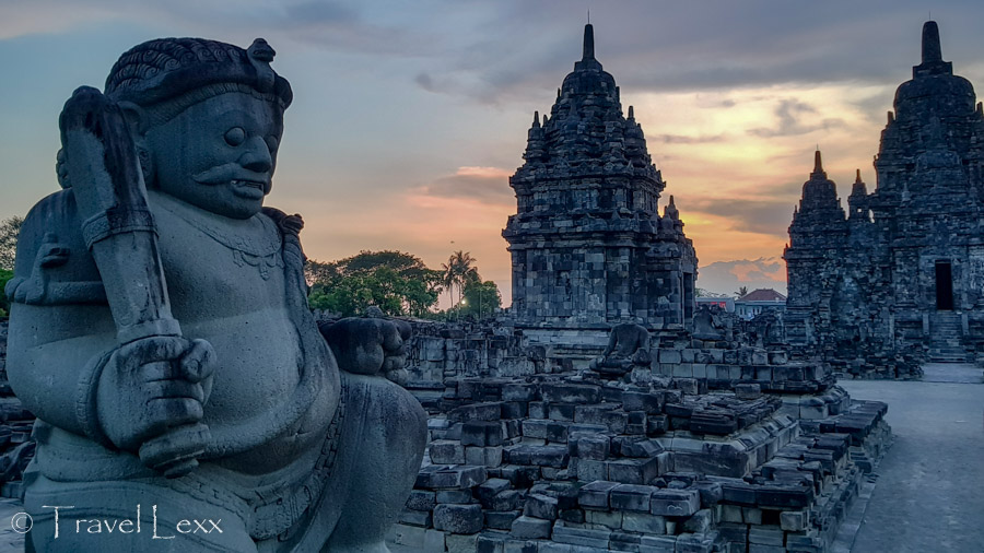A statue in the foreground of a temple in Yogyakarta, Indonesia