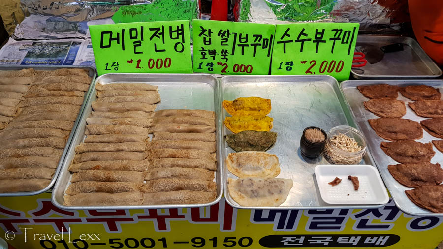 Rolled up buckwheat pancakes on trays at a market stall