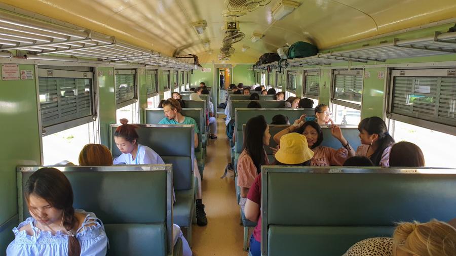 Passengers travelling from Bangkok to Kanchanaburi by train