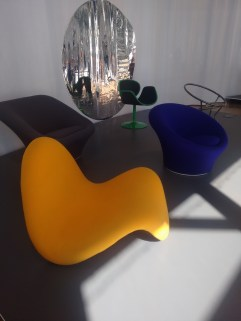 Tongue chair along with the grey and blue fauteuil (arm chair).