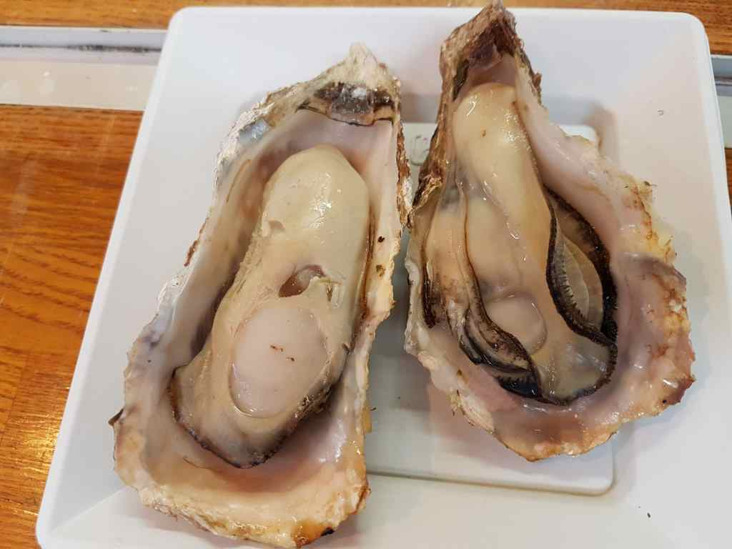Tasting the oysters on Miyajima Island