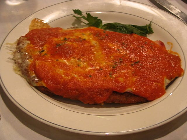 Milanesa a la Napolitana, a pizza-like dish inspired by Italian cooking