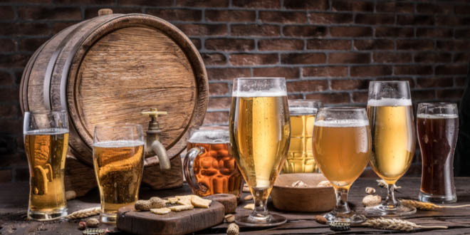 Glasses of craft beers and ale barrel, a collection from the best beer cities