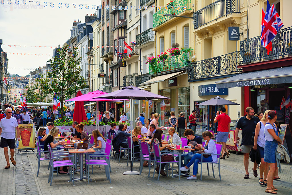 Pedestrians street with restaurant terraces in Dieppe