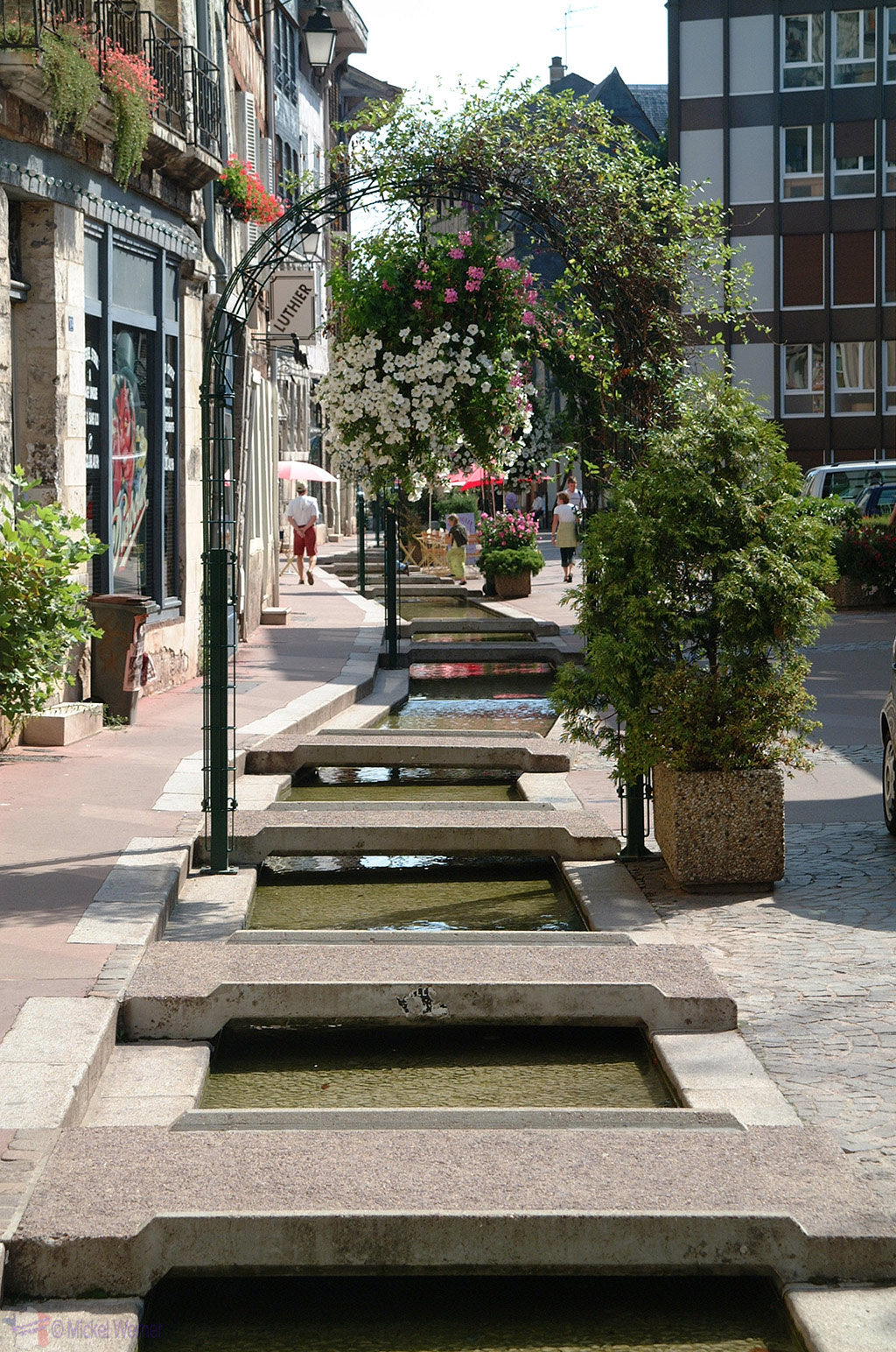 Little stream built-in the road in Rouen