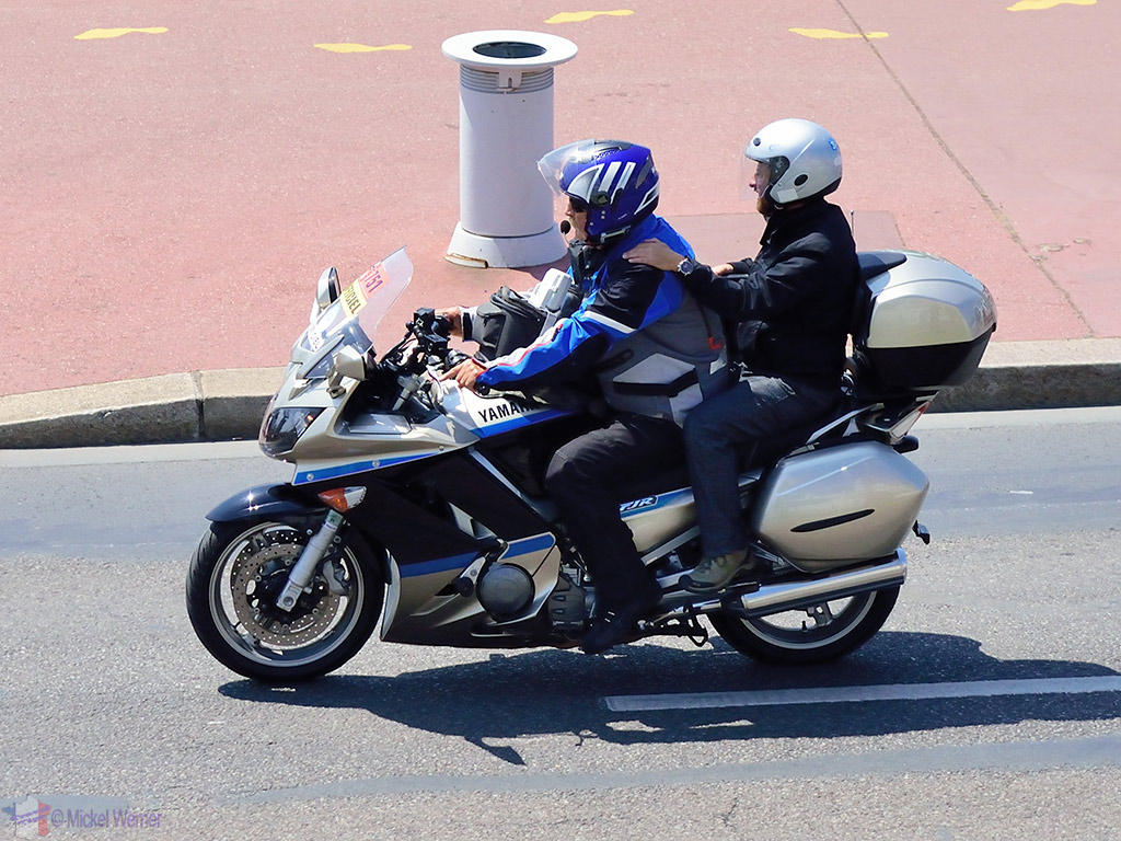 1st motorcycles carrying journalists arrive at the Tour de France