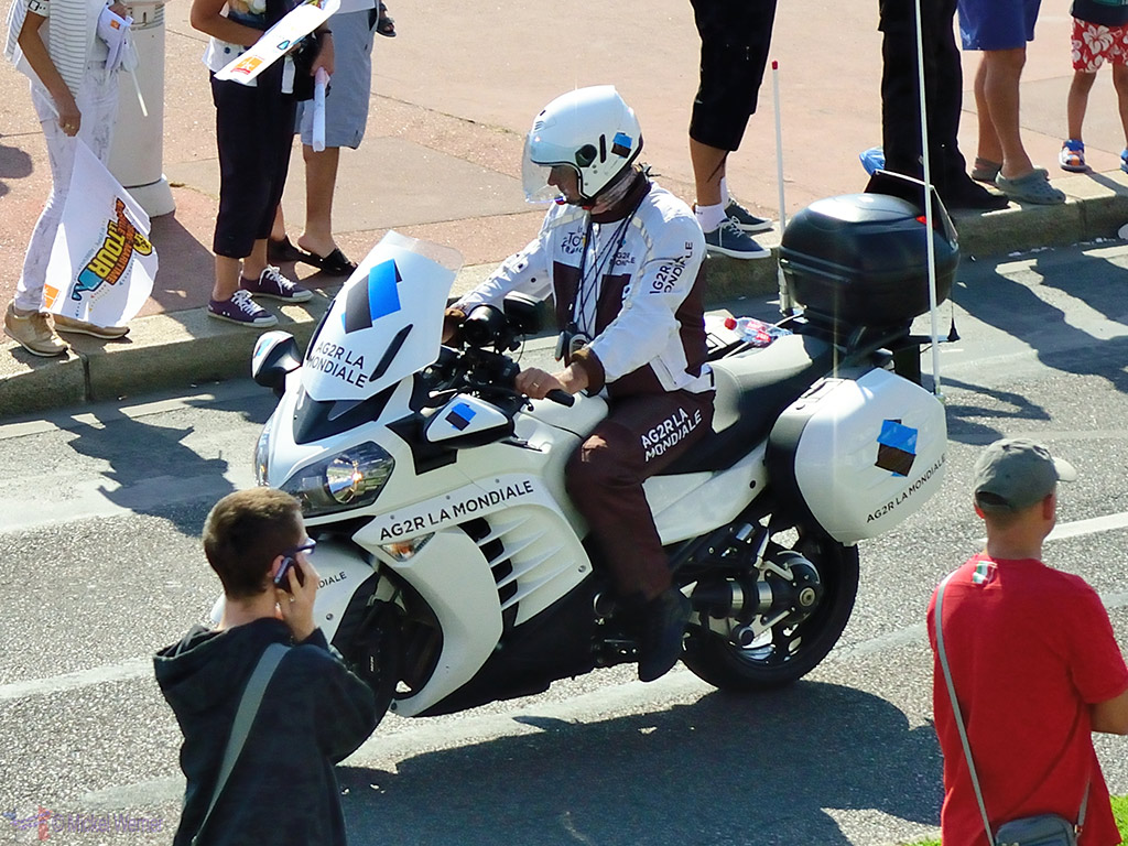 Medical assistance on an official motorcycle on the Tour de France