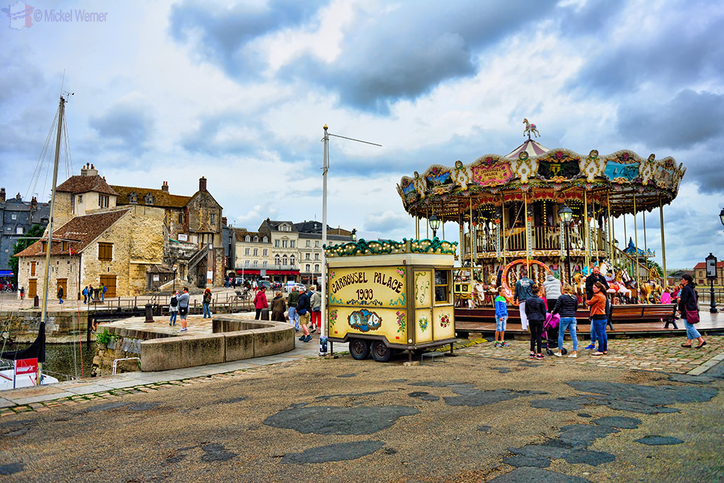 Merry-go-round at the old harbour of Honfleur