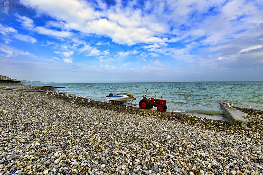 Tractor brings in a boat at Veules-Les-Roses