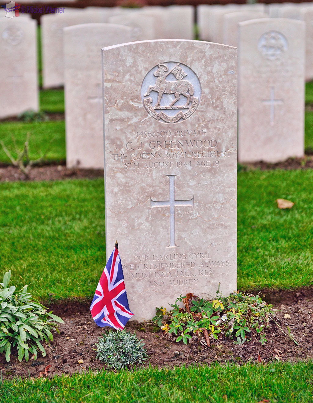 Graves and British flag at the British War Cemetery of Bayeux