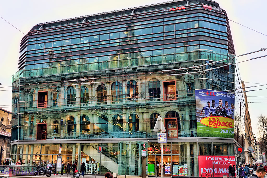 Reflection of the former commercial exchange (Palais de la Bourse) of Lyon in a small shopping centre