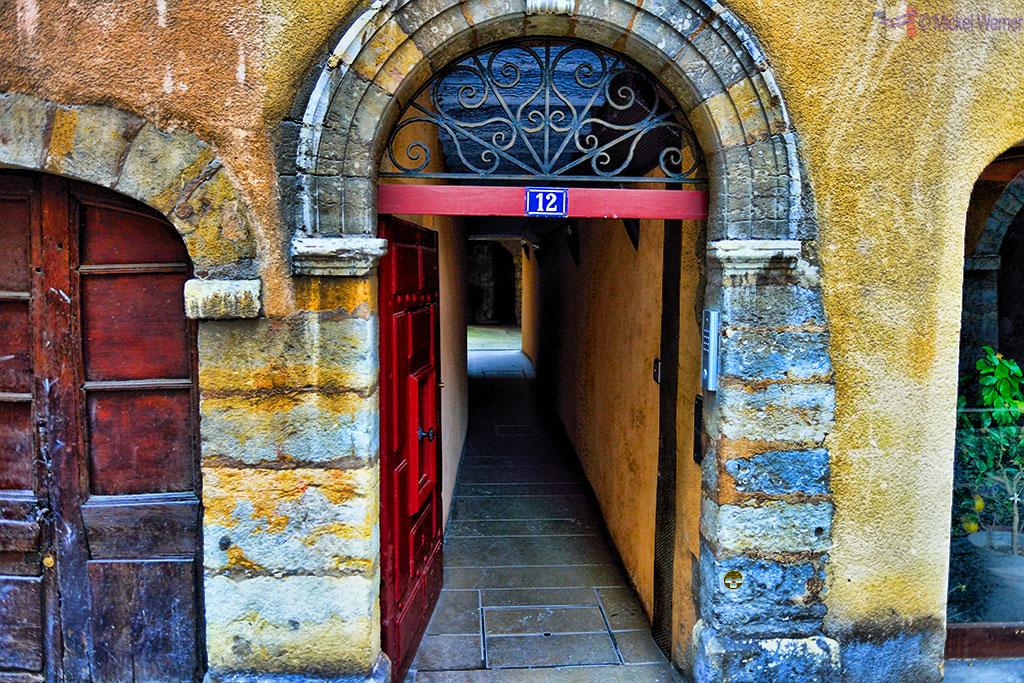 Traboule behind an open door in old Lyon