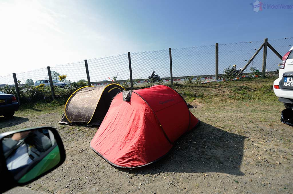 People camping alongside the roads to the Bugatti circuit in Le Mans
