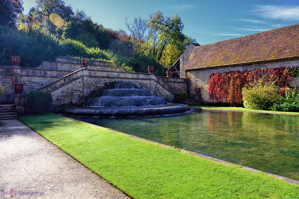 Fountain and fish lake of the Fontenay Abbey in Montbard, Burgundy
