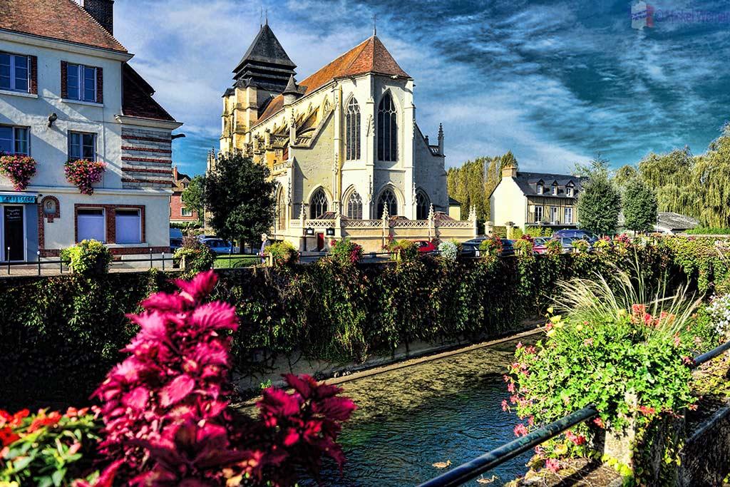 Saint-Michel church alongside the Touques river in Pont L'Eveque, Normandy